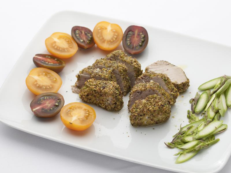 Tuna steak covered in pistachios